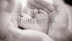 stock-photo-baby-feet-cupped-into-mothers-hands-109751450.jpg