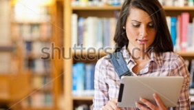 stock-photo-young-focused-student-using-a-tablet-computer-in-a-library-84634318.jpg