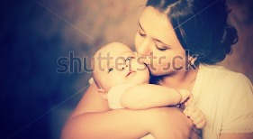 stock-photo-young-mother-kissing-her-little-newborn-baby-137703866[1].jpg