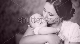 stock-photo-young-mother-kissing-her-little-newborn-baby-137703866[4].jpg