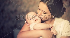 stock-photo-young-mother-kissing-her-little-newborn-baby-137703866.jpg