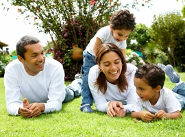young-family-playing-in-grass-montage.jpg